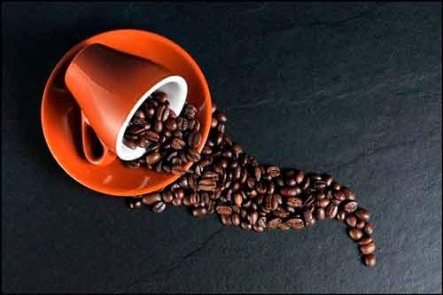 Taza con grano de café